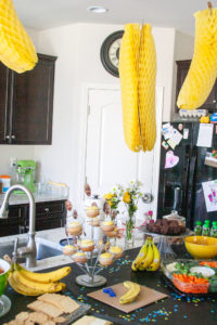food and decorations at a banana themed first birthday