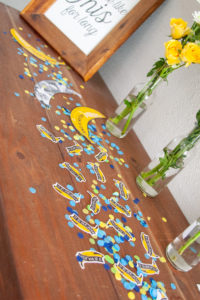 styled invitations and decorations at banana themed first birthday