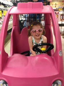 silly girl in shopping cart