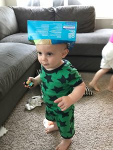 boy with box on his head