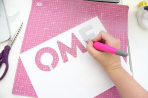 Cutting out letters for doormat stencil