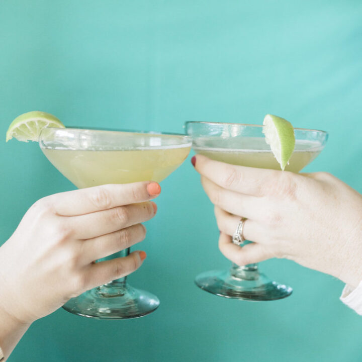 two full margarita glasses cheers