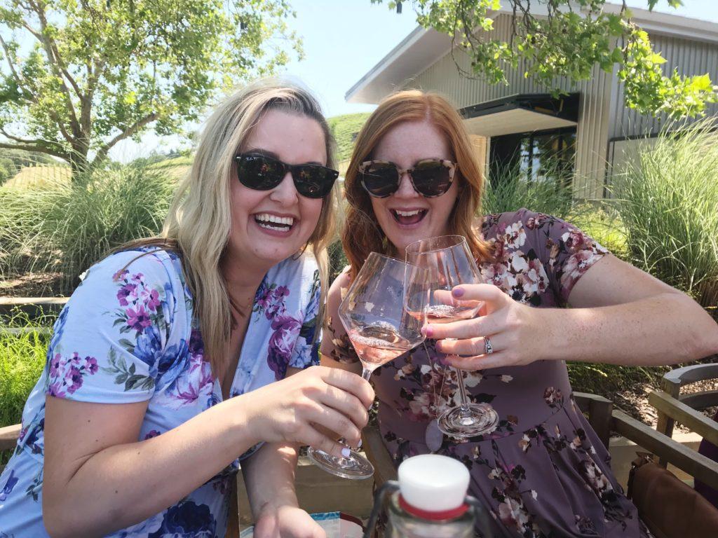 Okayest Moms cheers wine at MacRostie Winery