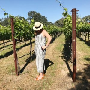 casual linen romper and fedora for wine tasting