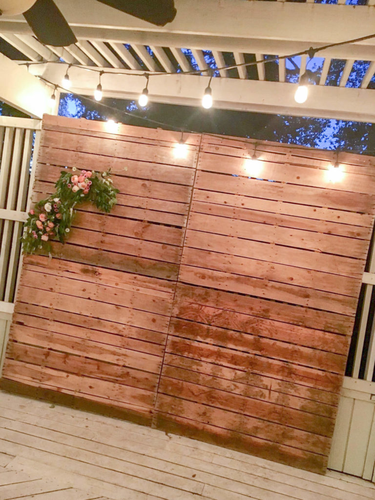 pallet wall photo backdrop at night