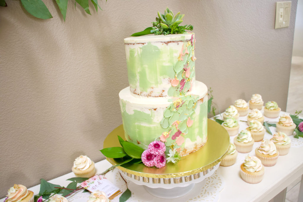 colored naked cake with flower accents