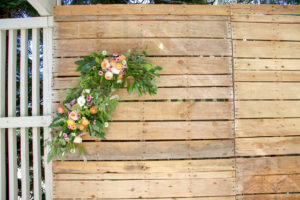 close up of florals on pallet wall