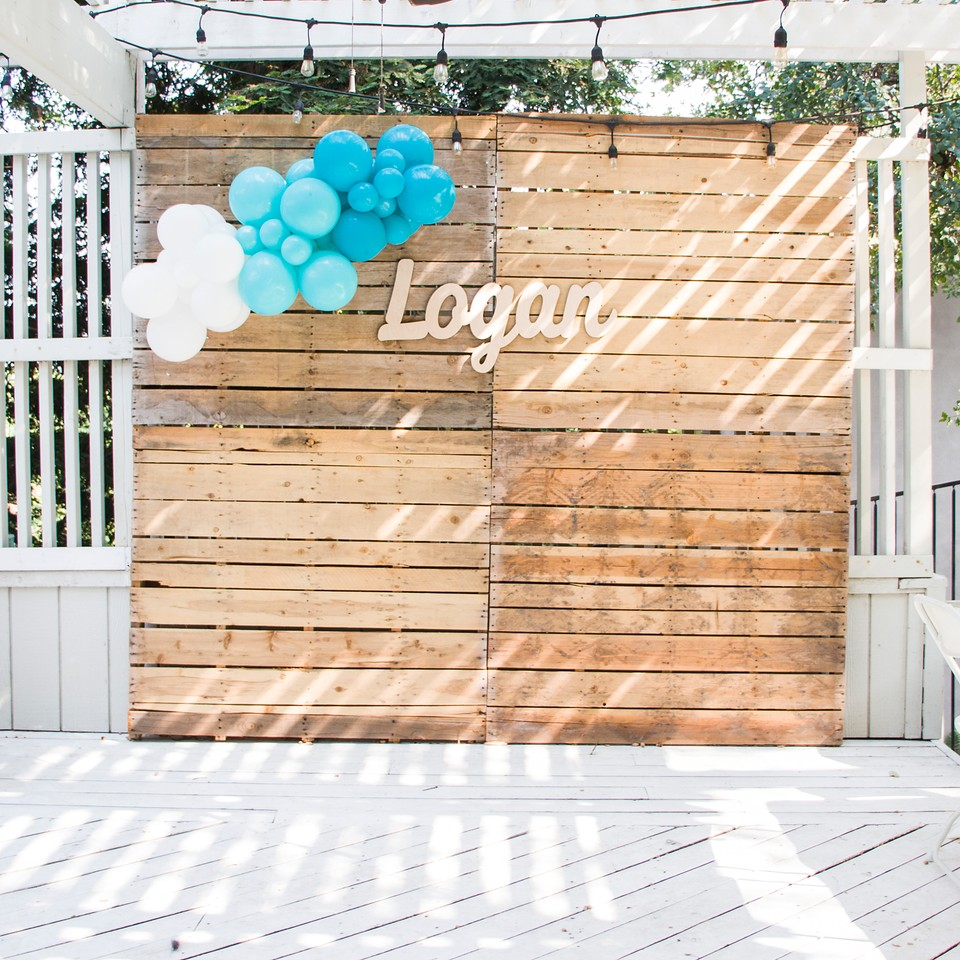 boy baby shower photo backdrop with balloon garland and baby name