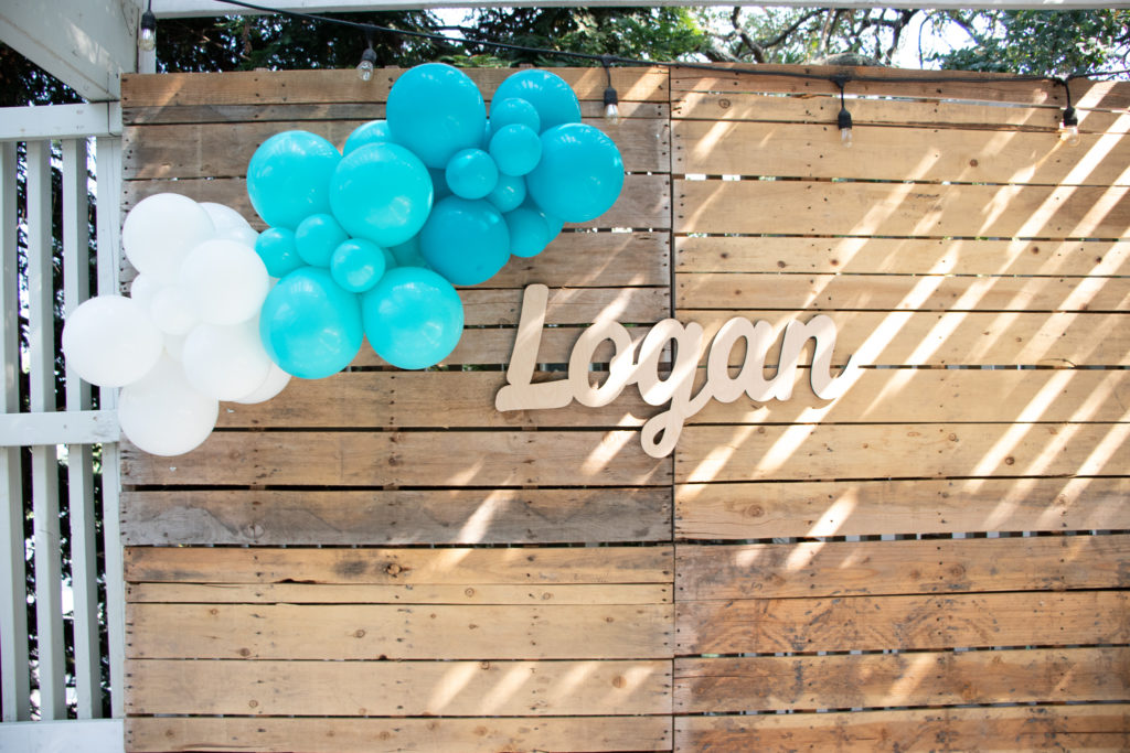 boy baby shower photo background with balloon garland and baby name