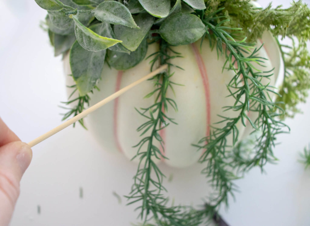 use the wooden skewer to hold the plant in place while the glue dries
