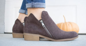 close up shot of a pair of fall booties under $100