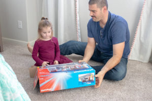 dad and daughter opening Playmobil Take Along Police Station
