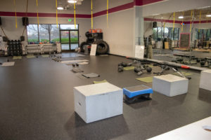Shot of the gym floor at Kaia Fit. They offer a varied workout routine every day.