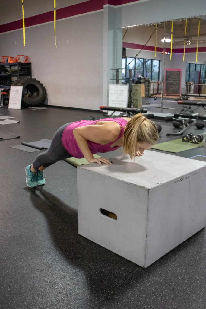 Brittany doing a push up on a box at Kaia Fit