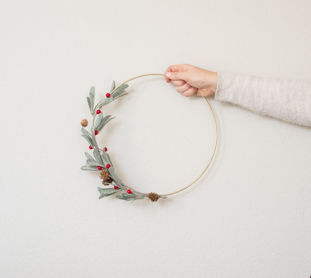 hand holding completed hoop wreath