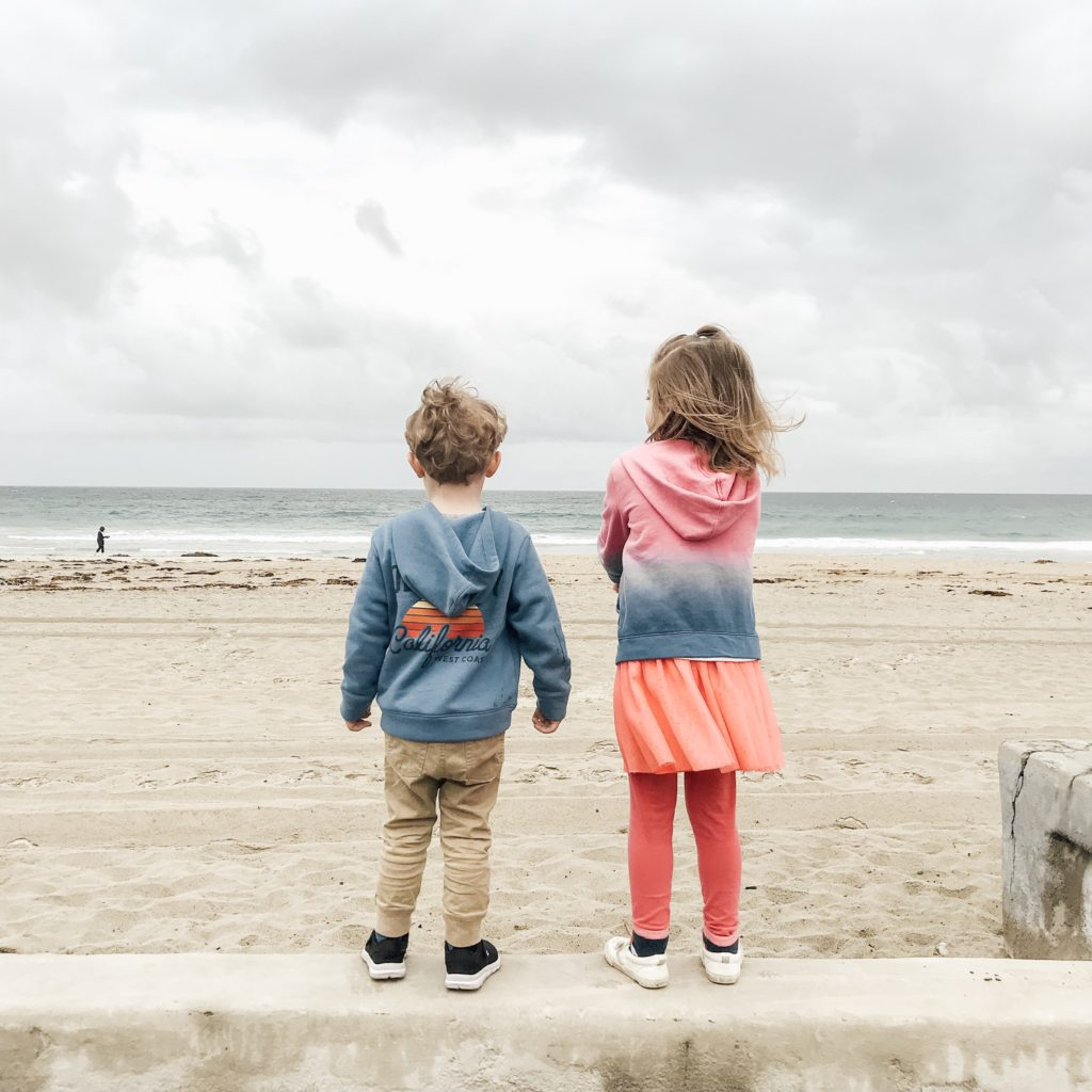 Children looking at the beach