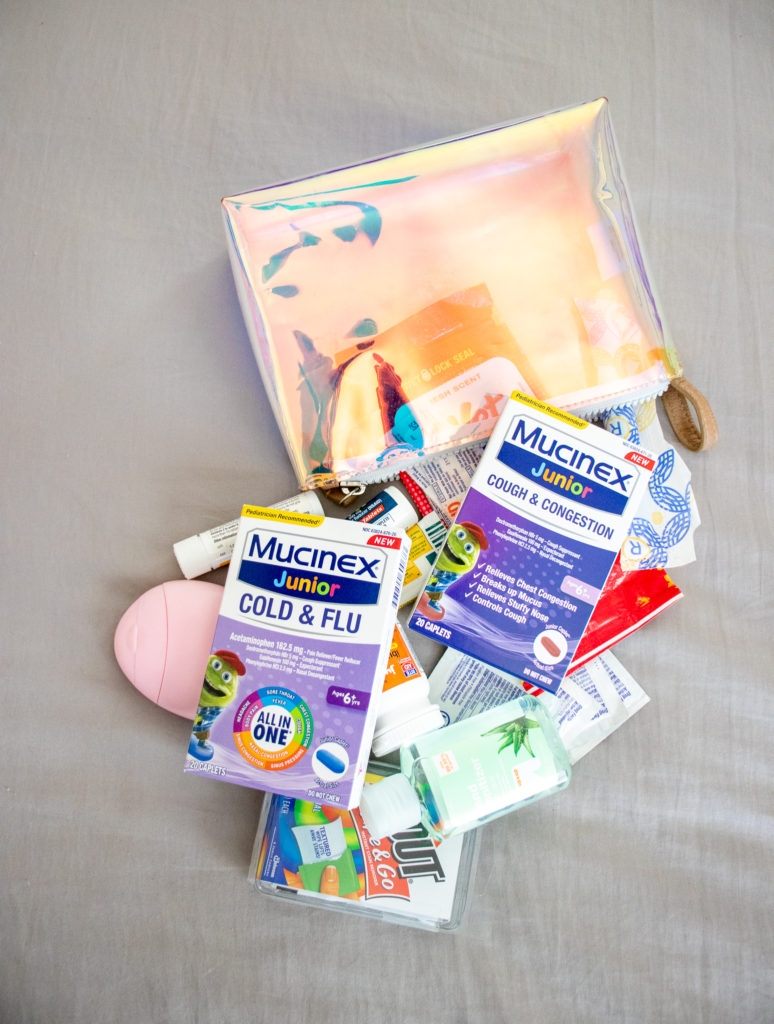 Putting smaller objects into a pouch keeps your Mom Bag Essentials organized and easier to find- Okayest Moms