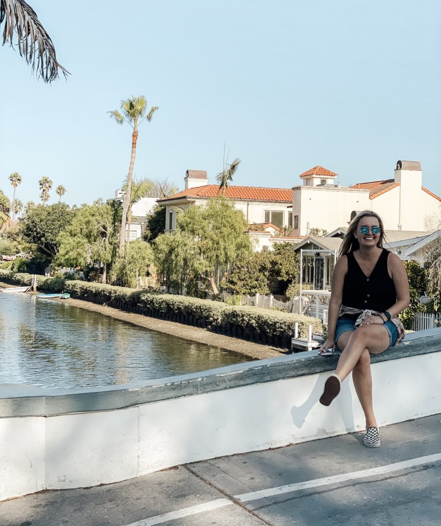 Brittany sitting along the Venice Canals in Venice Beach