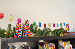DIY Pom Pom Christmas Trees displayed in playroom