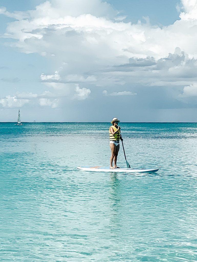woman on paddle board in ocean