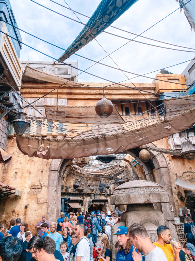 How We Got Boarding Passes for Rise of the Resistance in Disneyland // View of a Marketplace in Galaxy's Edge // www.okayestmoms.com