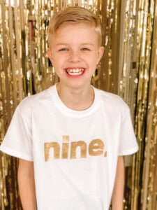 9 year old in NINE shirt
