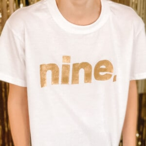 white shirt with nine in gold letters