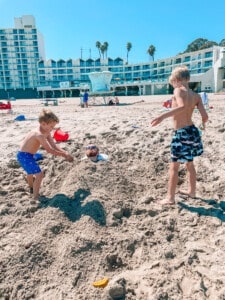 kids burying their dad in the sand
