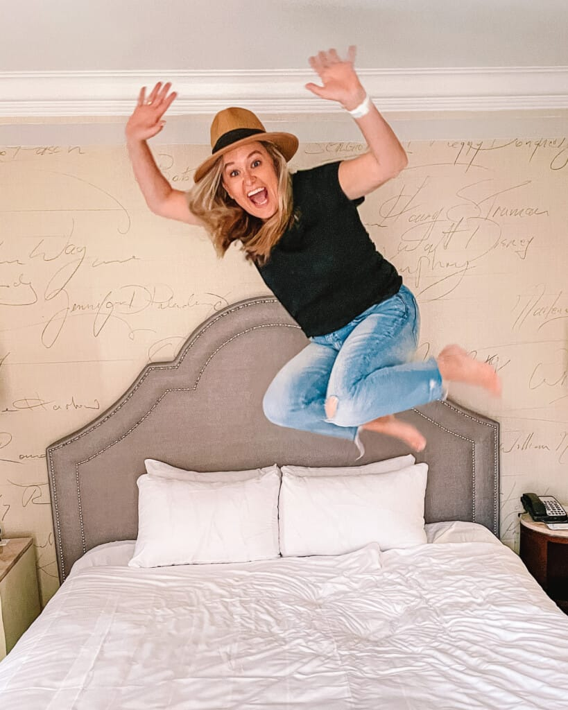 hotel room at the mayflower woman jumping on bed