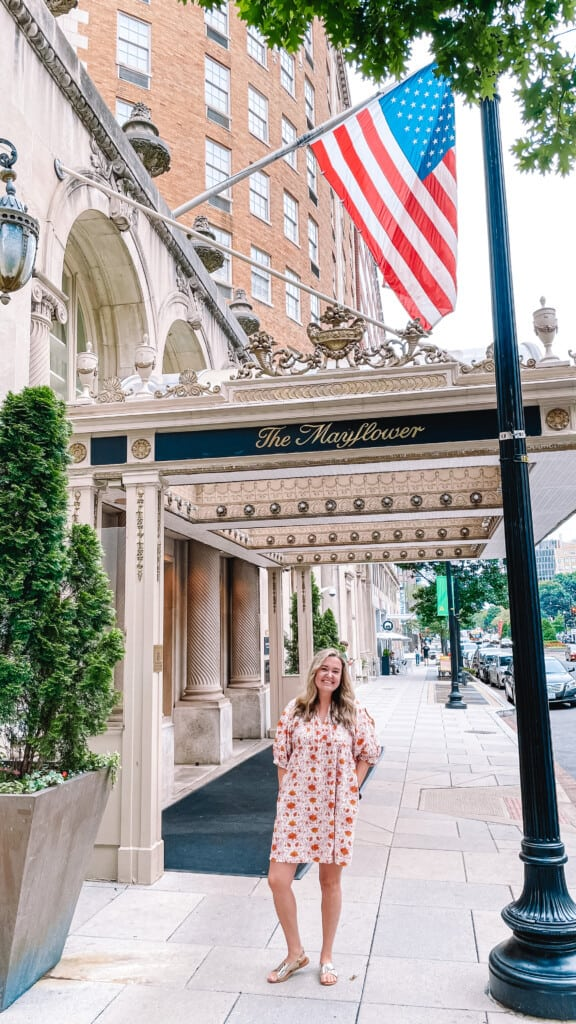 woman in front of mayflower hotel