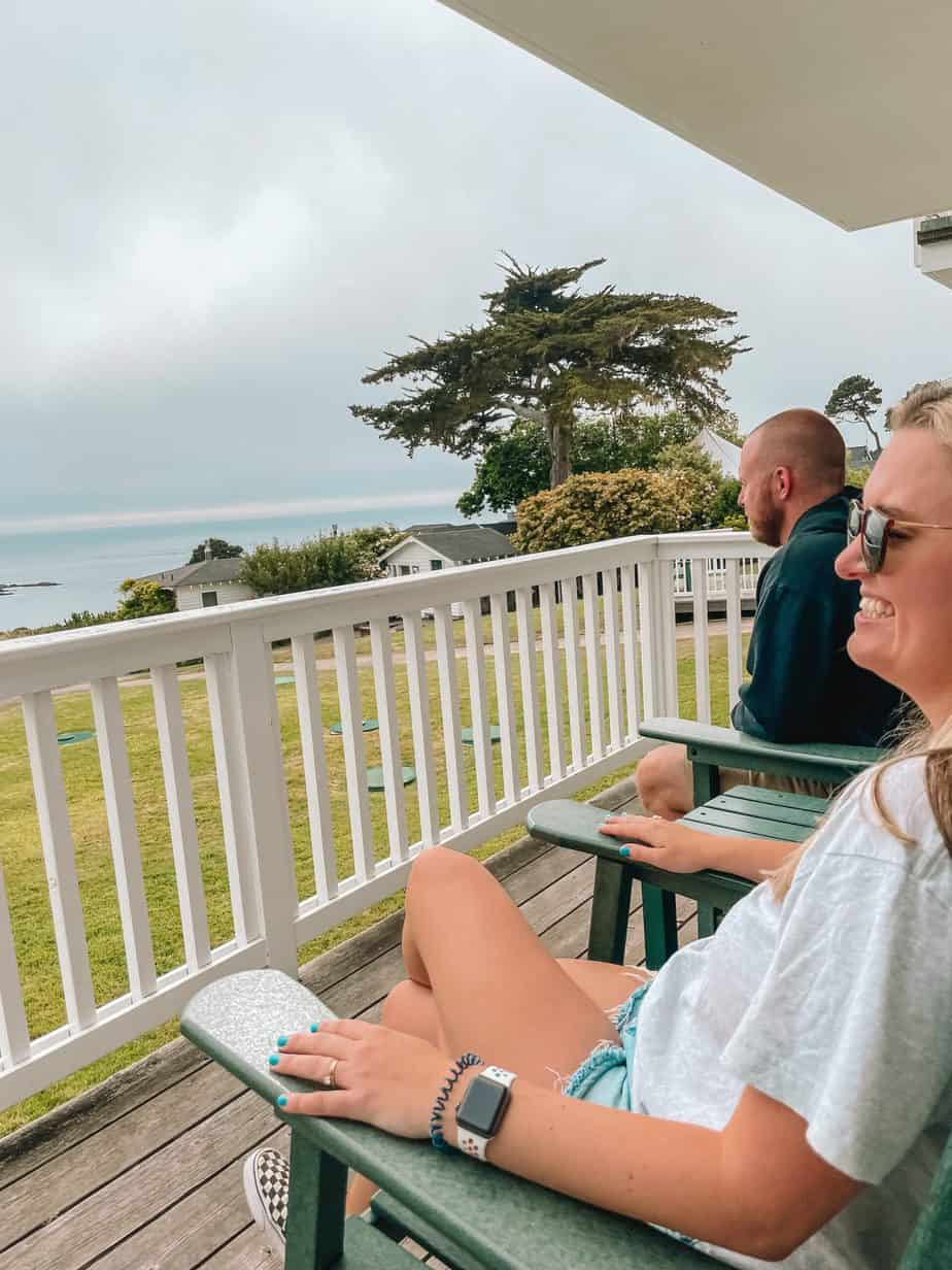 sitting on porch at little river inn oceanview room