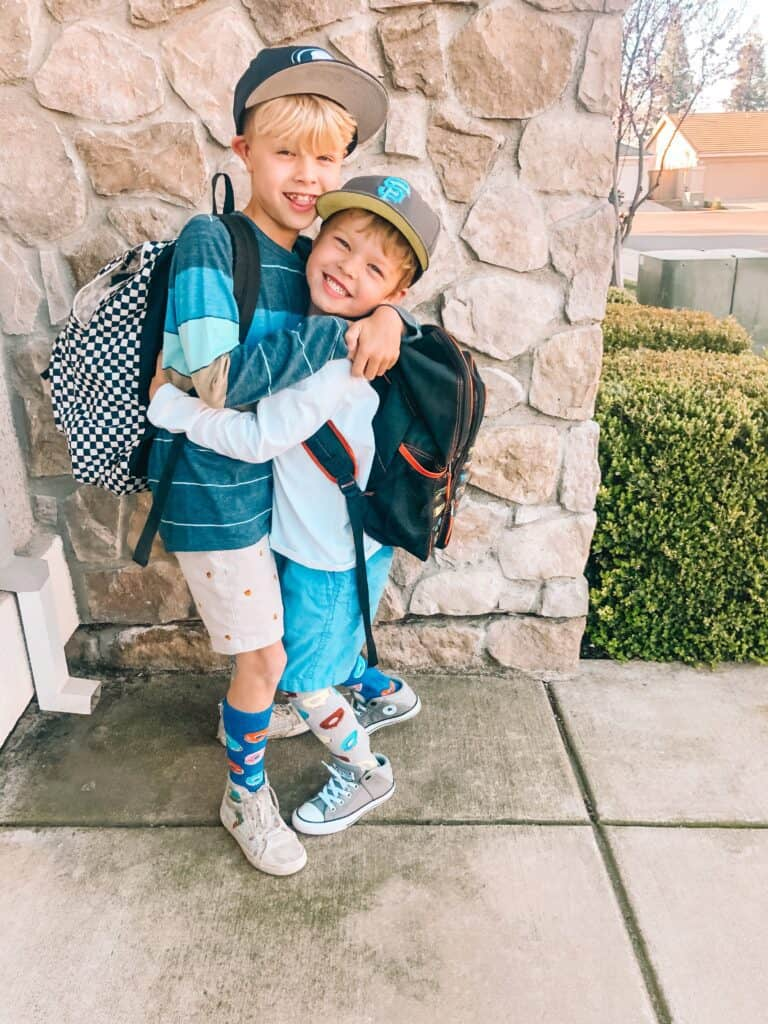 two boys with backpacks on