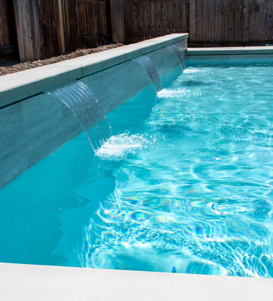 Sheer descents into a modern, rectangular swimming pool